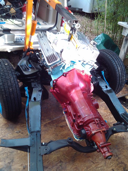 5/29/2014 -  Set the completed engine and transmission back into/onto the frame ! A big day ! Masked off the brake line and fuel line to repaint the front part of the frame.