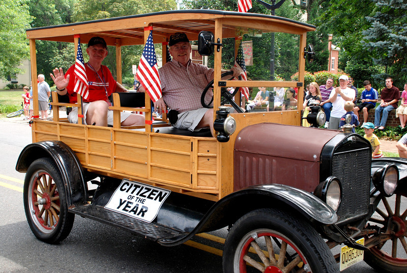 The photo shows BUCS (SCW), Ret. Dave Schill (rear) in BU2 George Mills' 1927 'Hack' in Moorestown's 4th of July parade. Schill served in Vietnam with CBMU-301 and CBMU-302 while his BU A School classmate Mills served in Vietnam in NMCB-7
