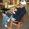 Seabee John O'Brien and his Wee-Bee in the in the rocking chair built by Senior Chief John Wilborn