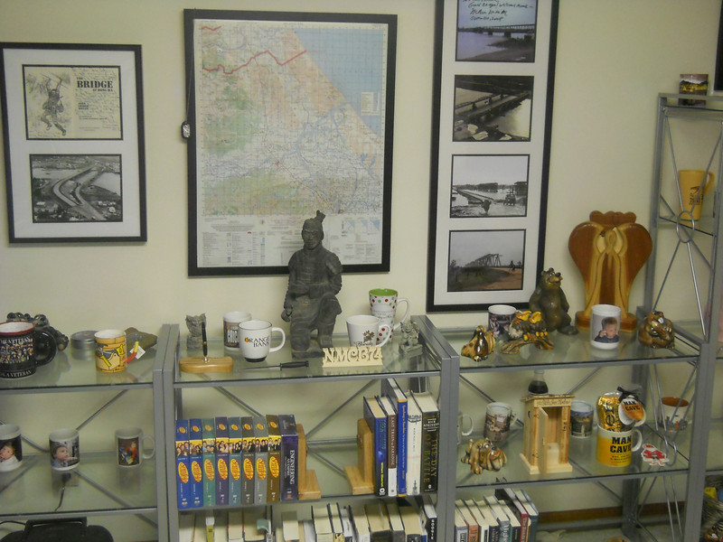 Hand made mementos from Fellow Seabees...NMCB-74 made by EO Glen Wallin...pen holder, book ends, one-holer, and John's Angle all made by Senior Chief John Wilborn. The 'John's Angel' is a tribute to the Senior Chief's son who die a few years ago. He makes the 'Angels' and gives them to people who are experiencing a loss. Mine was given to me because we are friends. Thank you Senior Chief