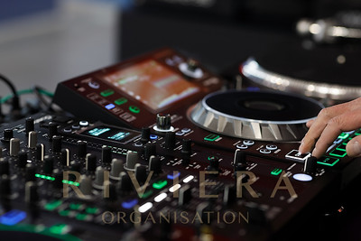 Dj Using A Sound Mixer Controller To Play Music. Selective Focus.