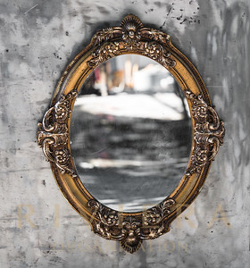 Old, Victorian, gilded, decorative frame with a mirror, baroque, rococo, the Renaissance