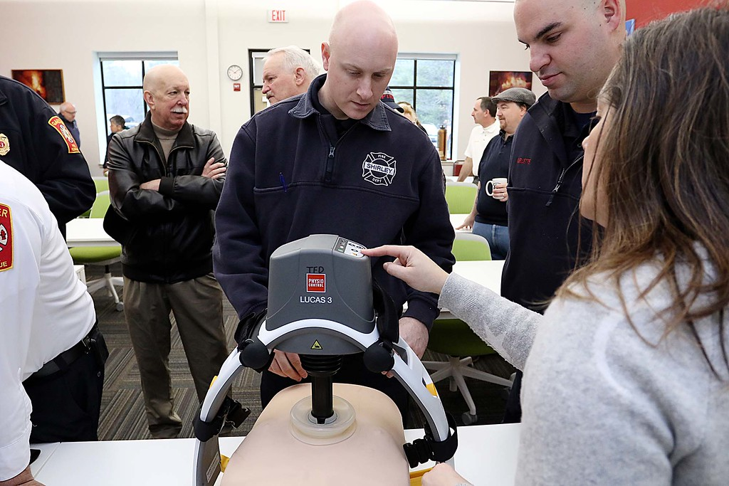 . A donation of Lucas 3\'s to fire departments from all over the region was held on Saturday at the Townsend Fire Department. Shirley Firefighters Brian Feddersen and Adam Ouellette listen to Crystal Perry as she explains the device as they got to try it out for themselves. SENTINEL & ENTERPRISE/JOHN LOVE