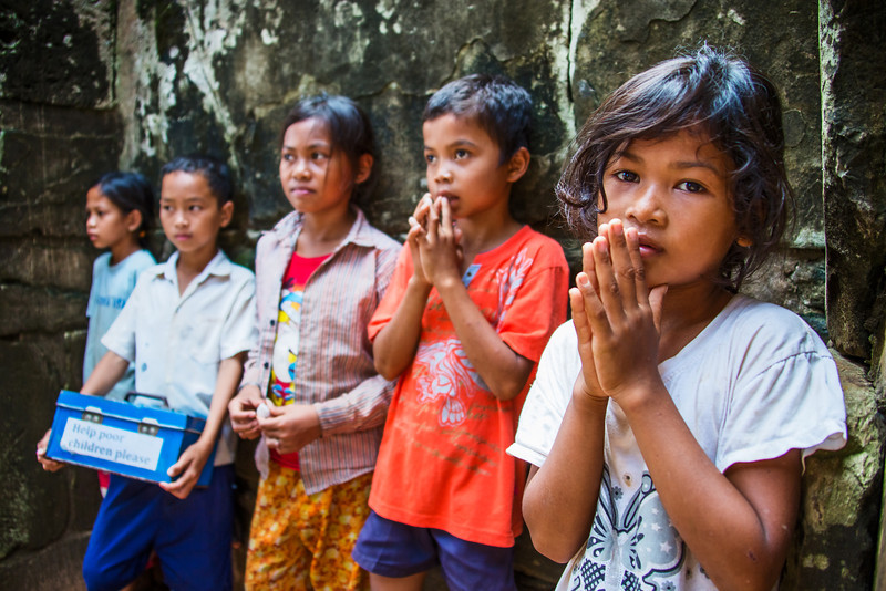 Children beg for money at a temple in Cambodia.   Canon 5D Mark III, Canon 28-300, 1/200 sec, f/3.5