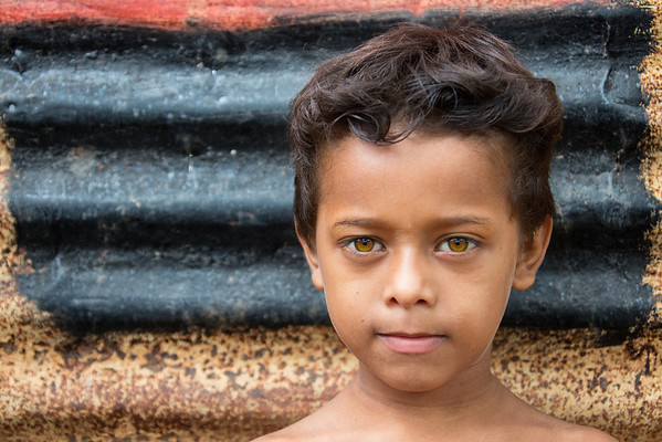 A boy stands outside of his home in a barrio in Granda, Nicaragua.  Canon 5D Mark III, Canon 70-200, 1/60 sec, f/5