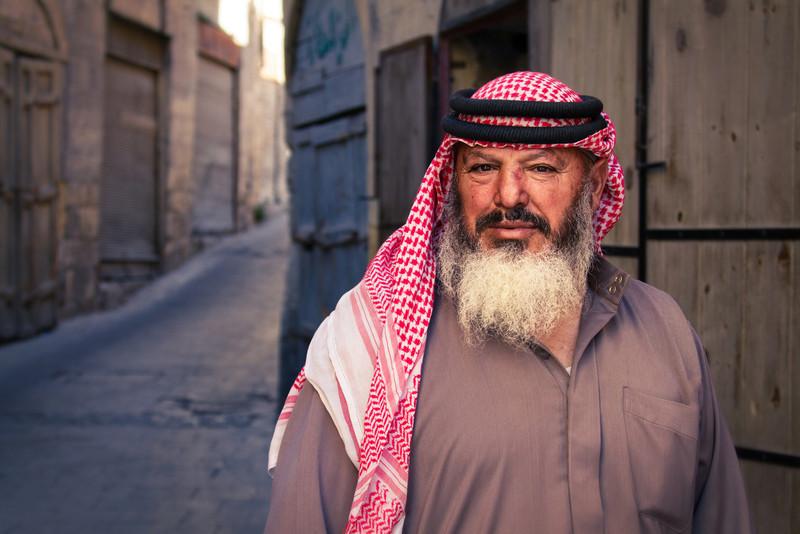 A merchant outside of a narrow ally way in Al-Salt, Jordan.   Canon 7D, Canon 28-300mm , 1/400 sec, f/5