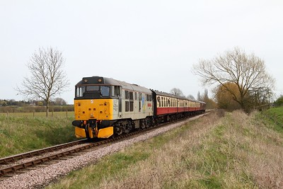 31271 on the 1M48 1250 Peterborough to Wansford at Castor on the 10th April 2016
