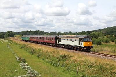 33063 on the 2T64 1115 Eridge to Tunbridge Wells at Pokehill farm crossing on the 5th August 2016