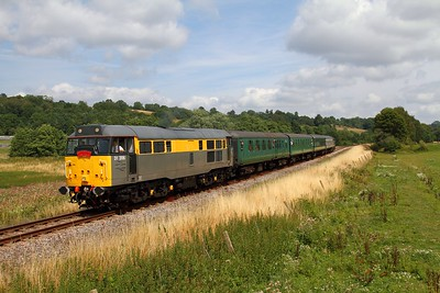31206 on the 2J67 1320 Tunbridge Wells to Eridge at Pokehill crossing near Groombridge on the 1st August 2014