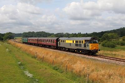 31206 on the 2T64 1115 Eridge to Tunbridge Wells at Pokehill farm crossing on the 1st August 2014