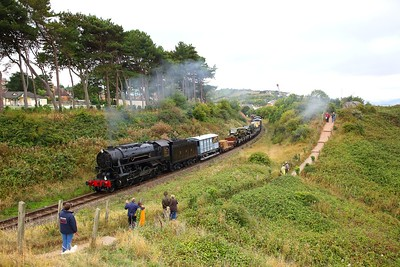 USA 6046 on the 1115 Minehead to Norton Fitzwarren military goods at Splash Point, Watchet during the 1940s weekend on the 16th September 2018