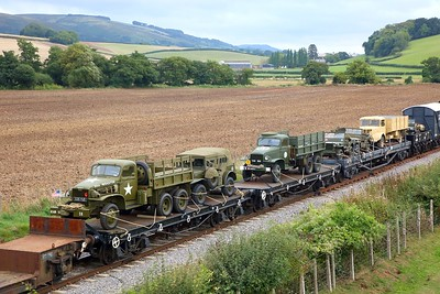 Military vehicles on the military goods train at Williton on the West Somerset Railway during the 1940s event on the 16th September 2018
