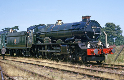 Even photographs taken during the early days of preservation can be a source of nostalgia! The pioneer GWR 'King' class 4-6-0 no. 6000 'King George V' had the distinction of becoming the locomotive which heralded the return to main line steam in the autumn of 1971. The locomotive was photographed at an open day at the erstwhile Bulmer Railway Centre, Hereford in 1974. BRC was a significant player in the preservation movement when many of today's heritage lines were in their infancy. The centre closed in 1993 to make way for additional factory space.