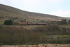 Against the backdrop of Coity Mountain, 73128 heads towards Furnace Sidings, P&BR, on 22nd March 2008.
