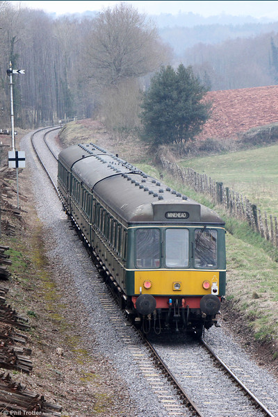 The WSR's class 115 dmu heads away from Crowcombe Heathfield forming the 1510 Bishops Lydeard to Minehead on 1st April 2013.