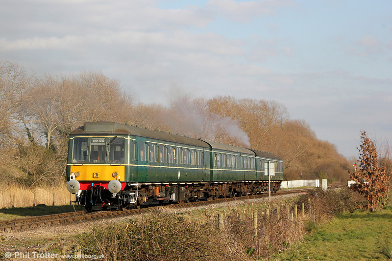 The WSR's class 115 dmu makes its customary rasping sound from the twin exhausts as it heads away from Minehead forming the 1735 to Bishops Lydeard on 31st March 2013.