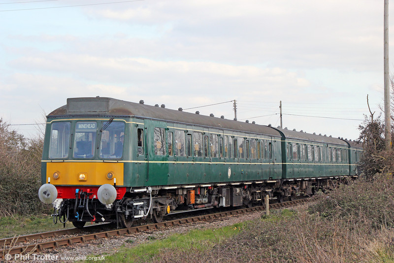 The WSR's class 115 dmu departs from Dunster forming the 1510 Bishops Lydeard to Minehead on 31st March 2013.