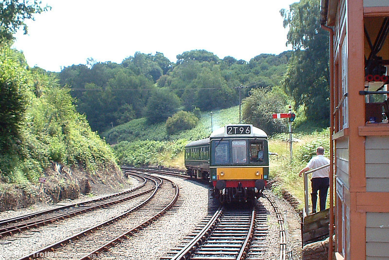 The signalman at Norchard waits to take the token from the driver of the Dean Forest Railway's class 108 dmu as it approaches Norchard Low Level with the 1315 from Lydney Junction on 9th July 2005.