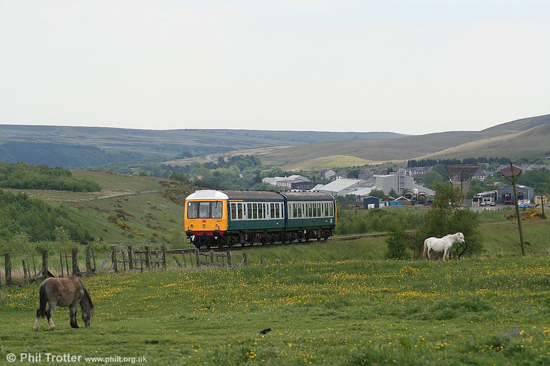 Against the backdrop of a post industrial landscape, the Pontypool & Blaenavon Railway's 'Derby Lightweight' class 108 dmu (cars W50632 and W52044) in action on 4th June 2006.
