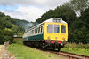 The Gwili Railway's class 117 dmu passes Cwmdwyfran Crossing on 14th August 2010.