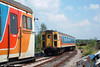 A summer's day on the 'Southern'? No! This is Lydney Junction, Dean Forest Railway, on 9th July 2005. Former Lymington Branch regular 3-Cig unit 1499 faces 4-Cig unit 1392.