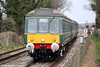 The WSR's class 115 dmu calls approaches Dunster forming the 1510 Bishops Lydeard to Minehead on 30th March 2013.