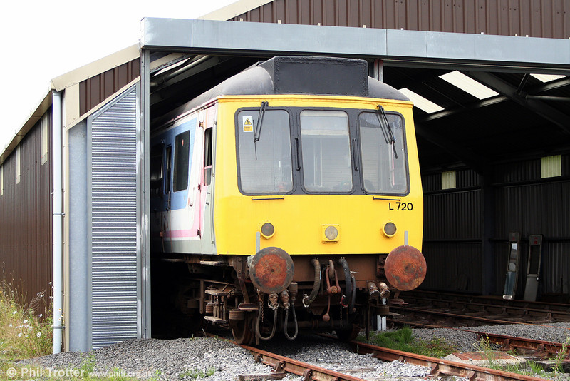 L&MMR class 117 DMBS 51354 pokes its head out of the running shed at Cynheidre on 11th July 2010.