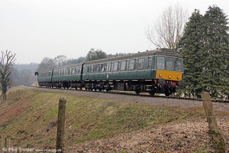 The WSR's class 115 dmu passes Roebuck Gate forming the 1320 Minehead to Bishops Lydeard on 1st April 2013.