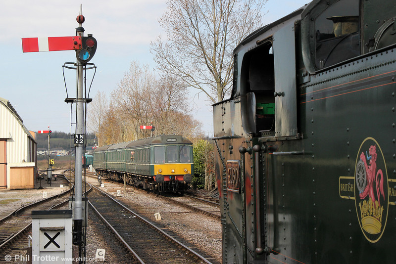 The WSR's class 115 dmu crosses 2-6-2T no. 4160 at Williton, the dmu forming the 1320 Minehead to Bishops Lydeard on 31st March 2013.