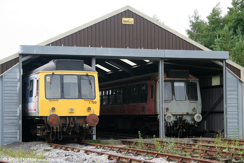 Cynheidre dmu depot! A view of the L&MMR stock shed at Cynheidre on 11th July 2010 with class 117 DMBS 51354 (left) and class 107 DMC SC52029.
