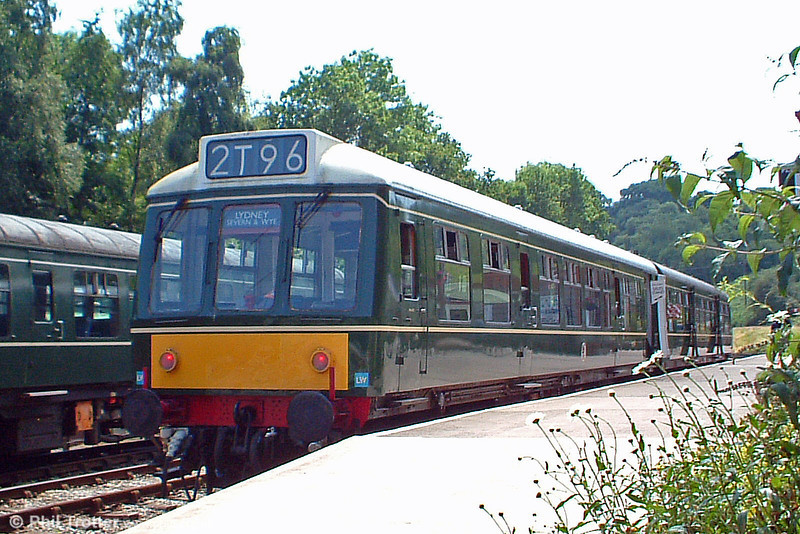 The Dean Forest Railway's class 108 Derby Lightweight unit of 1958 vintage slumbers in the heat of a summer afternoon at Norchard Low Level, 9th July 2005.