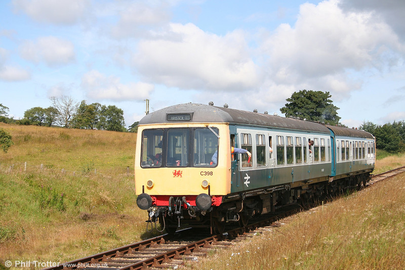 The driver of the P&BR's class 108 dmu prepares to surrender the token at Furnace Sidings on 28th July 2007.