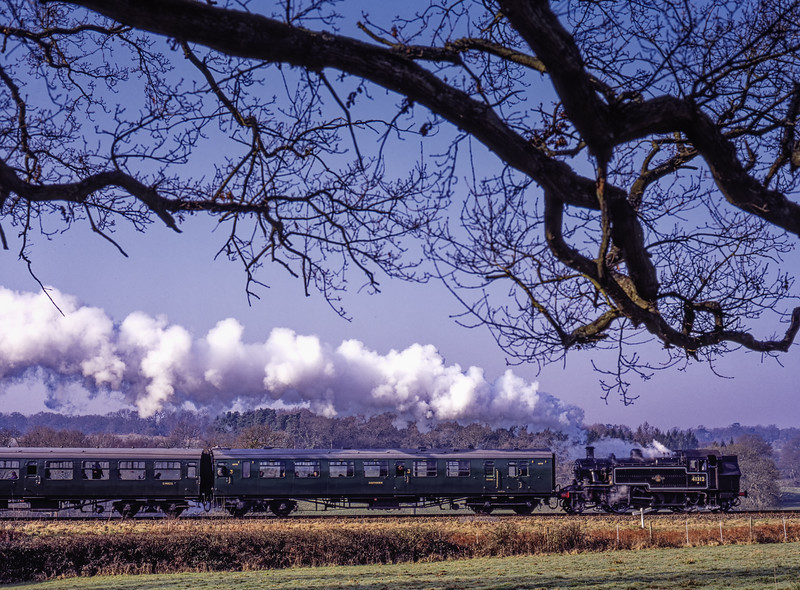 Visiting Ivatt No. 41312 approaching Caseford Bridge, with the 09:50 Sheffield Park - Kingscote, during the Branch Line Weekend, on 22nd February 2003.