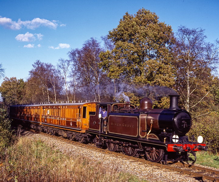 """E4 class No. 473 """"Birch Grove"""" approaching Caseford Bridge, <br /> with the 13:00 Kingscote - Sheffield Park, on 13th November 2004."""