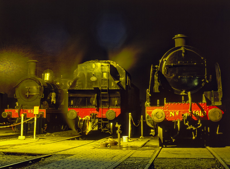 01 class No. 65, Ivatt No. 41312 and U class No. 1618 under the yard lights at Sheffield Park, during the Branch Line Weekend on 22nd February 2003.