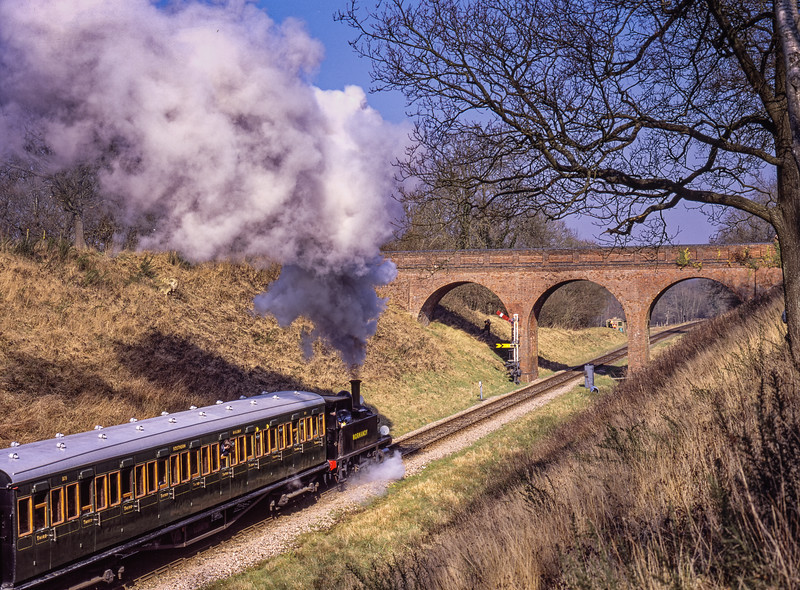 """B4 class No. 96 """"Normandy"""" at Three Arch Bridge, with the 10:55 Sheffield Park - Kingscote, during the Branch Line Weekend, on 22nd February 2003."""