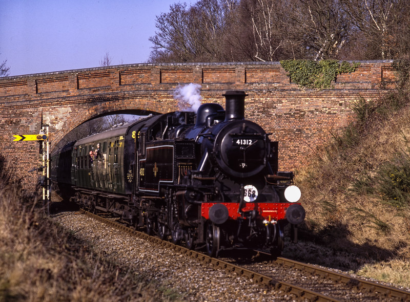 Visiting Ivatt No. 41312 at Caseford Bridge, with the 13:22 Kingscote - Sheffield Park,  <br /> during the Branch Line Weekend, on 22nd February 2003.