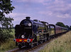 """Schools Class No. 928 """"Stowe"""" on Freshfield Bank, with the 15:37 Sheffield Park - Horsted Keynes, on 23rd August 1981."""