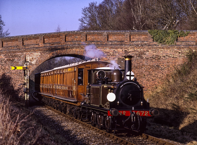 LB&SCR No. 672 at Caseford Bridge, with the 13:57 Kingscote - Sheffield Park,  <br /> during the Branch Line Weekend, on 22nd February 2003.