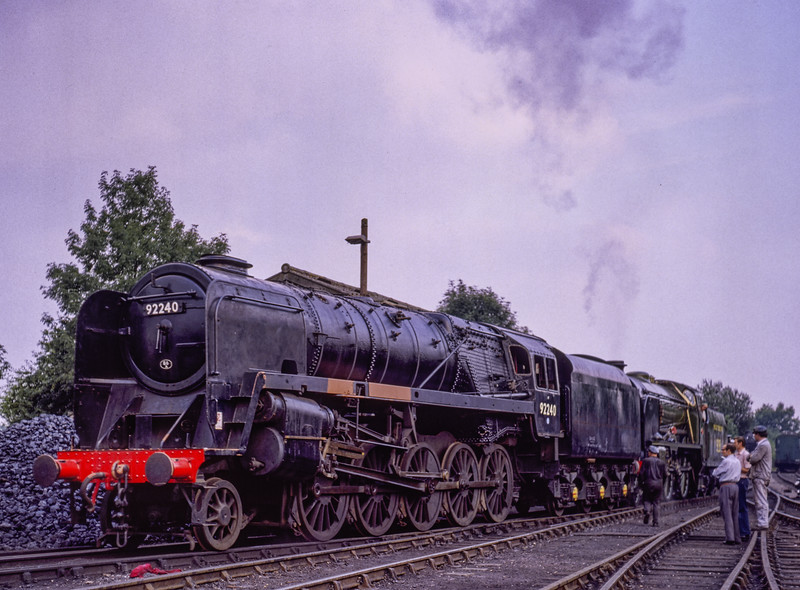 """9F No. 92240 being moved around the yard at Sheffield Park, <br /> by Schools Class No. 928 """"Stowe"""", on 23rd August 1981."""