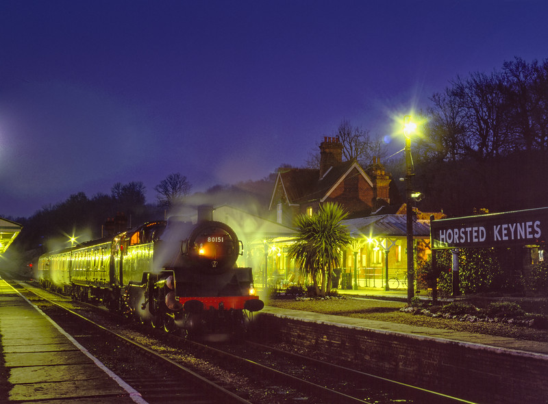 Standard 4 Tank No. 80151 pauses at Horsted Keynes with the 17:26 Kingscote - Sheffield Park, during the Branch Line Weekend on 22nd February 2003.