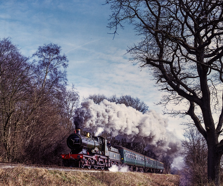 """3440 """"City of Truro passes Baigents Copse with the 10:16 Alton - Ropley, during the Steam Gala on 13th March 2005. Scanned Transparency."""