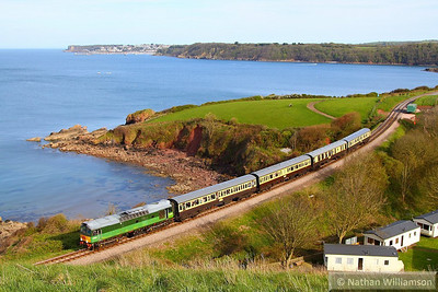 "D7535 (25185) passes Waterside Caravan Park on the Devon Diesel Society's ""The Seaside Sulzer""  17:40 Kingswear to Paignton Queens Park 04/05/13  Watch the video at: http://youtu.be/MtbudAwAgwU"