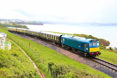 D7535 climbs past Waterside Caravan Park on: 16:41 Paignton Queens Park to Kingswear 27/04/14  Watch the video at: http://youtu.be/9vuP5wuBJiU