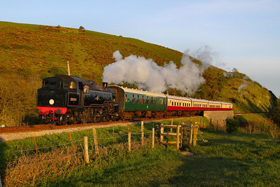 80104 crosses Corfe Castle Foot Crossing with the dining charter, forming the: 1N10 19:30 Swanage to Norden  11/05/12  Watch the video at: http://youtu.be/p08AQpz7Dmc