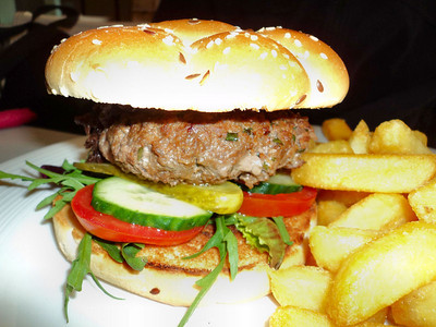 "Handmade gourmet beef burger served in a Kaizer bread bun with chips and salad. £9.00. Served in ""The Bankes Arms Hotel"" in Corfe Castle  11/05/12"