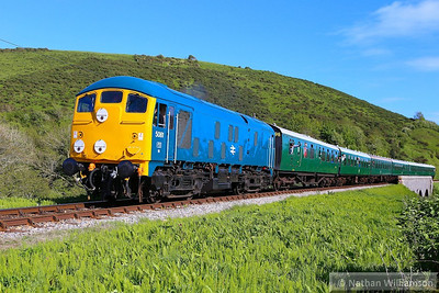 24081 heads north past Corfe Castle Foot Crossing on: 2N24 16:45 Swanage to Norden 11/05/14  Watch the video at: http://youtu.be/Inqu-xNxoU0