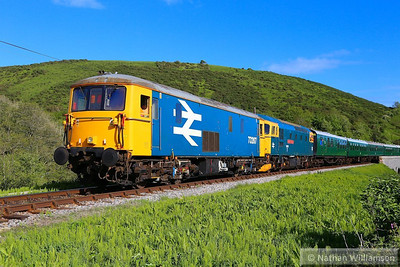 73207 & 33202 head south past Corfe Castle Foot Crossing on the rear of: 2S23 17:30 Norden to Swanage  11/05/14