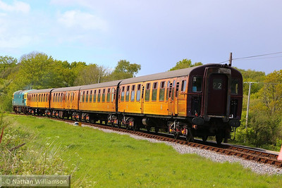 4TC No 413 heads south past Corfe Castle Foot Crossing on: 1S09 15:35 Norden to Swanage  11/05/14