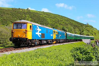 73207 & 33202 head north past Corfe Castle Foot Crossing on: 2N20 15:15 Swanage to Norden 11/05/14  Watch the video at: http://youtu.be/i0-ebDTlaDY